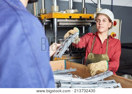 Woman as blue collar worker apprentice working in cooperation