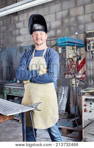 Man as welder and metalworker with experience in metallurgy workshop