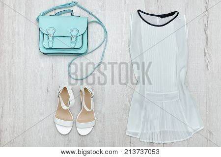 White Blouse, White Shoes And Handbag. Fashionable Concept. Wooden Background.