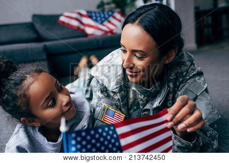 Daughter And Mother With American Flag