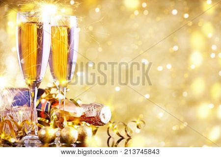 Merry Christmas and Happy New Year. A New Year's background with New Year decorations and champagne. New Year's card. Background with copy space.