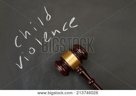 Judge gavel on blackboard background writing the word