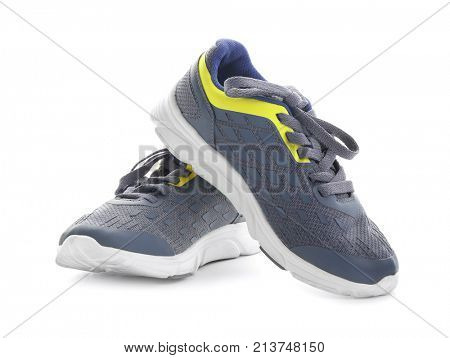 Pair of grey tennis shoes, isolated on white