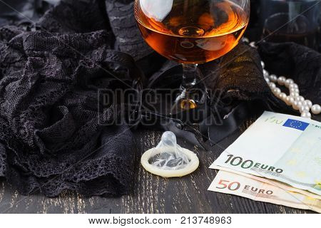 Prostitutes Or Striptease Concept, Euro Banknote With Sexy Laces And Condom
