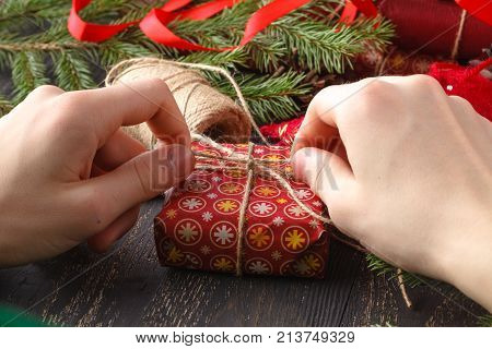 Man Wrap Christmas Gifts. Christmas Gifts In The Hands Of Man