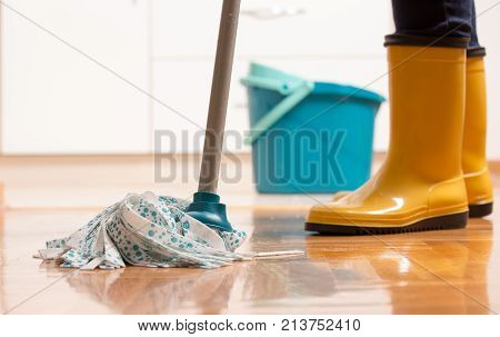 Housekeeper Mopping Tiled Floor