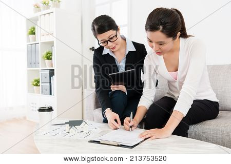 Business Woman Assisting Client Buying House