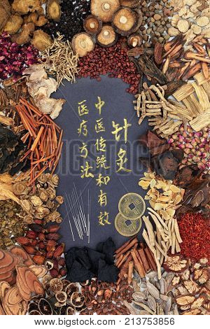 Chinese acupuncture needles, feng shui coins with traditional herbs and  calligraphy script  Translation reads as acupuncture chinese traditional and effective medical treatment solution method.