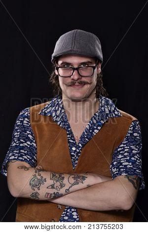 Cool trendy stylish optimistic tattoo artist portrait on black background.