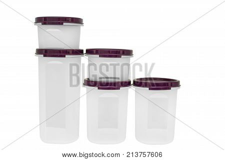 Close up set of plastic cups with purple lids stacked on each other