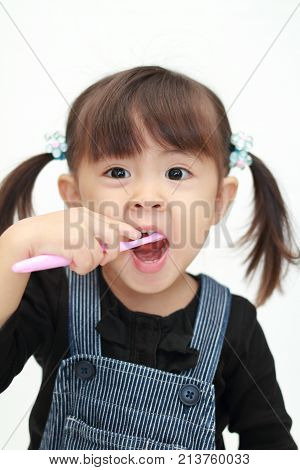 Japanese Girl Brushing Her Teeth (3 Years Old)