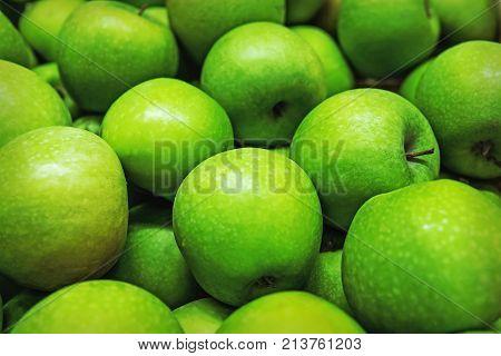 Green Background Of Granny Smith Apples. Horizontal.