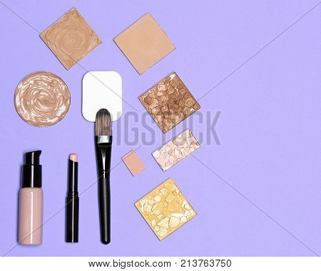 Makeup cosmetics for perfect complexion. Concealer, primer, foundation fluid with correcting, bronzing, highlighting, shimmer golden powder. Flat lay set, copy space