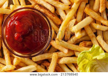 French fries and ketchup closeup - top view