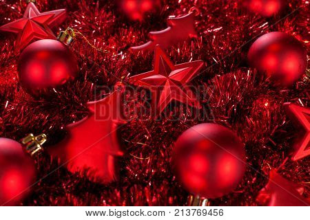 Red christmas ornaments and garlands - closeup