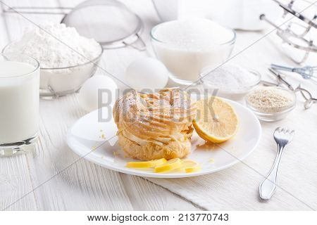 Ingredients for baking delicious cakes on a white wooden table. fresh bakery