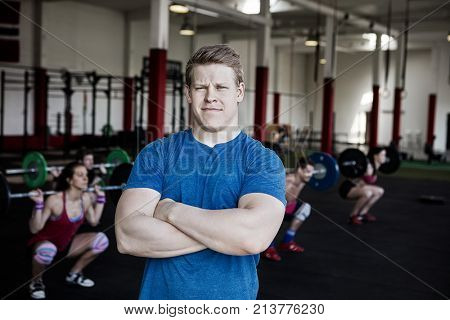 Confident Man Standing Arms Crossed In Gym