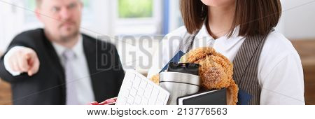 Angry yelling boss point arm to exit dismissing sad worker with stuff box portrait. Bad news pack and carry belongings hopeless human resources staff reduction hr get upset give sack concept
