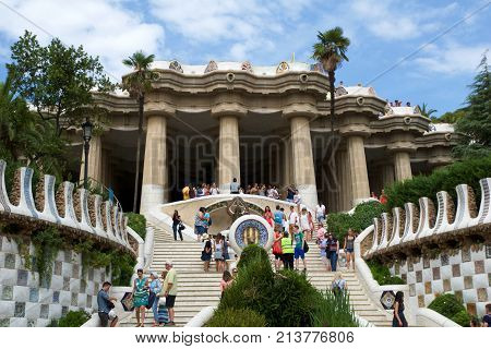 BARCELONA, SPAIN - AUG 30th, 2017: Entrance at the Park Guell designed by Antoni Gaudi with tourists at the stairs, Catalonia.