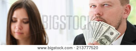 A man and a woman enjoy light money in the form of fraud. Demonstrate them in the camera and smile fairly