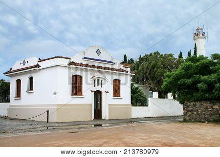 White Colonial House In Historic Quarter Of Colonia Del Sacramento, Uruguay.
