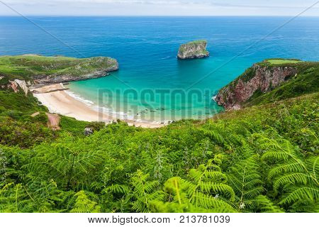 Ballota beach with the islet Castro Llanes Asturias Spain
