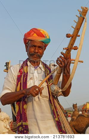 Pushkar, India, October 28, 2017 : Musician During The Festival. Pushkar Camel Fair Is One Of The La