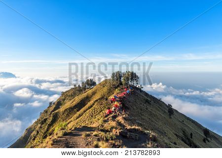 Camping site on crater rim of Mount Rinjani at sunset. Lombok Island Indonesia.