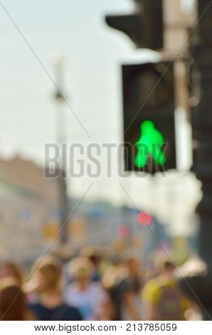 Traffic lights at a pedestrian crossing. On a green light to cross the road. Blur