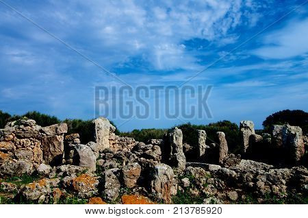 Ancient Megaliths Talaiot Settlement of So na Cacana against Blue Sky Outdoors. Menorca Balearic Islands