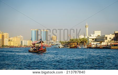 Dubai, UAE, October 7, 2015: Abra is making its way across Dubai Creek ferrying tourists and locals for only 1 dirham per person