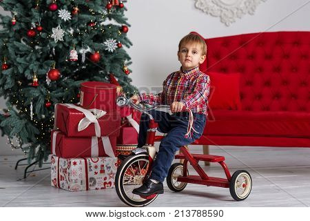 Boy Playing Near Christmas Tree