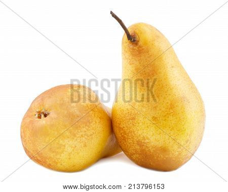 Two pears yellow beside. One is exactly another lies on a white isolated background