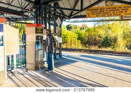 Burke, Usa - October 27, 2017: Man Buying Tickets For Vre Train To Washington Dc For Commute At Burk