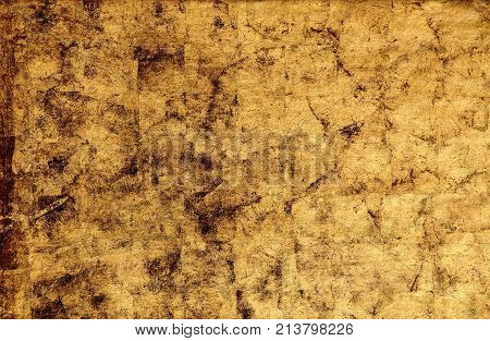 Gold wall texture background with dark impregnations