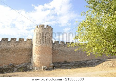 BELMONTE, SPAIN -JULY 29, 2017: Watchtower in the fort around the medieval castle in the village of Belmonte province of Cuenca Spain.