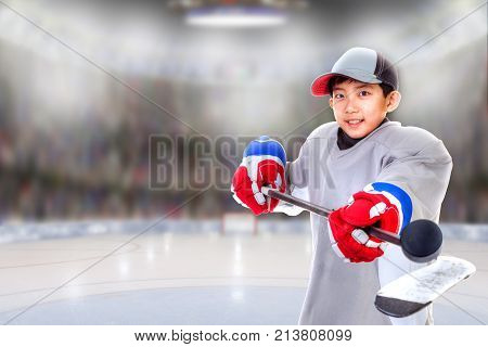 Junior Hockey Player Posing In Arena