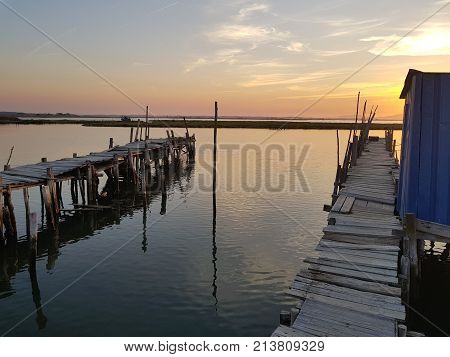 Sunset seen from the old harbor built in wood