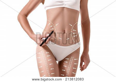 Female body with the drawing arrows on it isolated on white. Fat lose, liposuction and cellulite removal concept. Plastic surgery