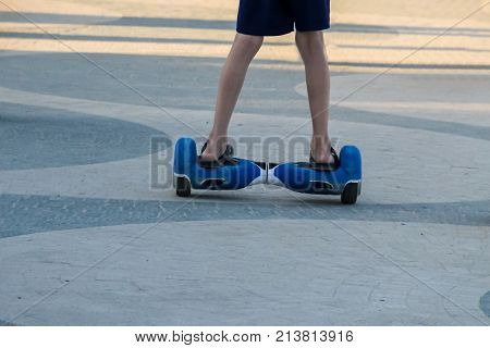 Legs Of Boy Riding On Self-balancing Mini Hoverboard In The City Street