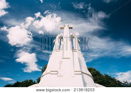 Vilnius, Lithuania. Famous White Monument Three Crosses On The Bleak Hill In Summer Sunny Day On Background Blue Sky. Bottom View