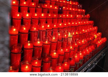 red candles in one of the chirches of Spain