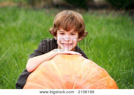 Boy And Large Pumpkin
