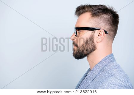 Side Profile Close Up Photo Of Successful Young Serious Handsome Brunet Bearded Businessman In Forma