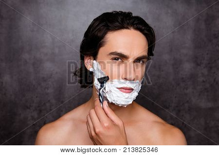 Close Up Of Face Of Concentrated Virile Mature Harsh Mulatto Hispanic Man With White Foam On His Fac