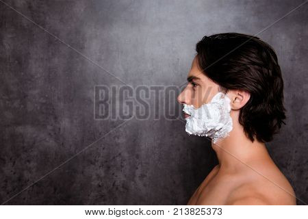 Close Up Side Profile Shot Of Face Of Concentrated Virile Mature Harsh Mulatto Hispanic Man With Whi