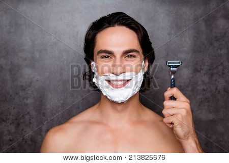 Close Up Of Face Of Mulatto Hispanic Man With White Foam On His Face, Isolated On Grey Background, S