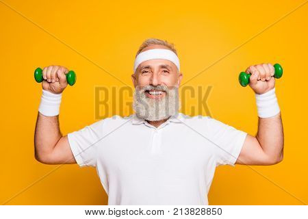 Cheerful Emotional Cool Grey Haired Grandpa With Humor Grimace Exercising Holding Equipment, Lifts I