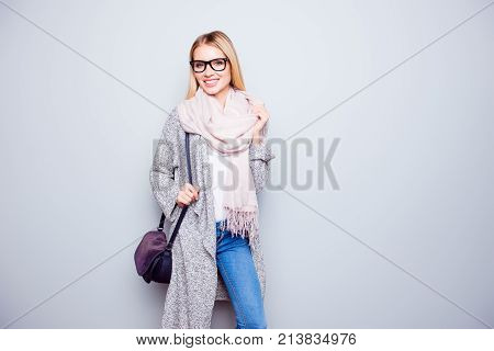 Portrait Of Attractive Happy Careless Young Woman With Beaming Smile Is Wearing Warm Cardigan, Scarf