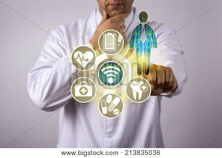 Unrecognizable doctor of medicine with pensive gesture is accessing and contemplating personal health care data of a male patient via a wireless computer network dashboard. Healthcare IT concept.